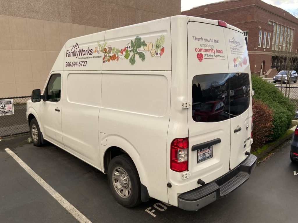 Photo of the FamilyWorks Food Rescue van, showing logo and artwork (hand drawn fresh produce)
